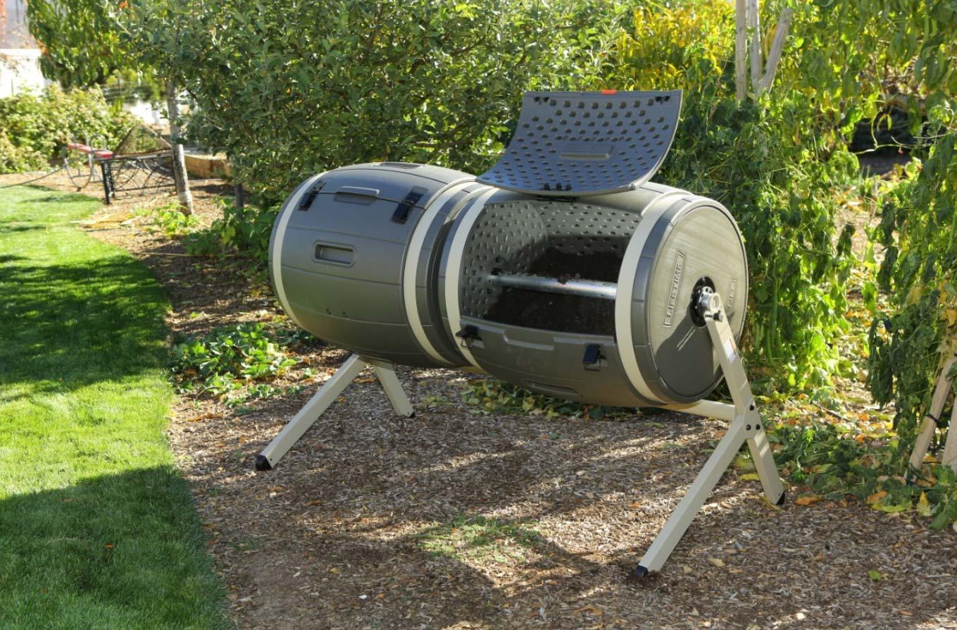 Compost tumbler near garden