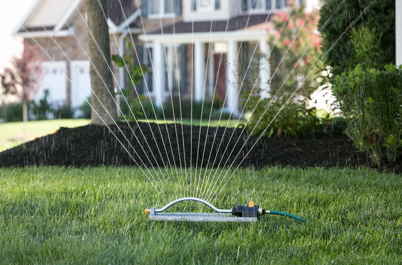 Oscillating sprinkler in lawn