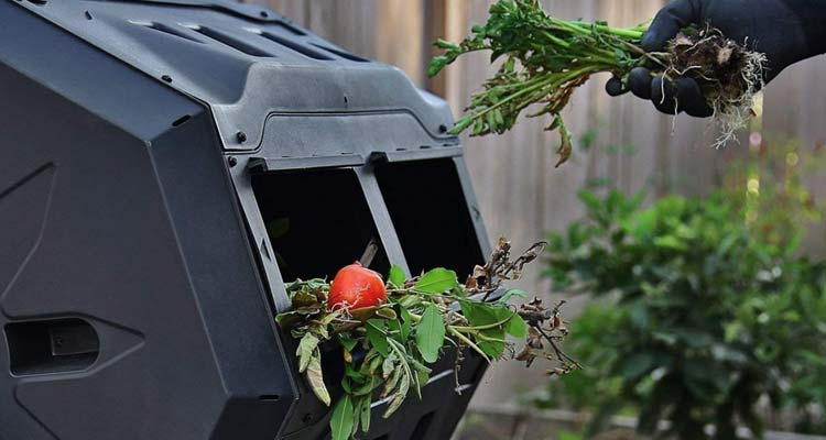 putting vegetables in compost tumbler